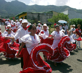 Children dancing in Boyeros Parade, Escazu, Costa Rica